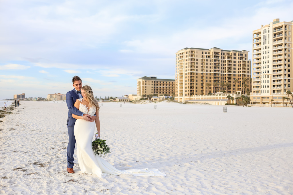 Outdoor Beach Wedding Portrait, Bride in Applique Lace Bodice Wedding Dress with White Floral, Blue Berry and Greenery Bouquet, Groom in Blue Suit with Blue Bow Tie   Tampa Bay Wedding Photographer Lifelong Photography Studio   Hotel Venue Hilton Clearwater Beach