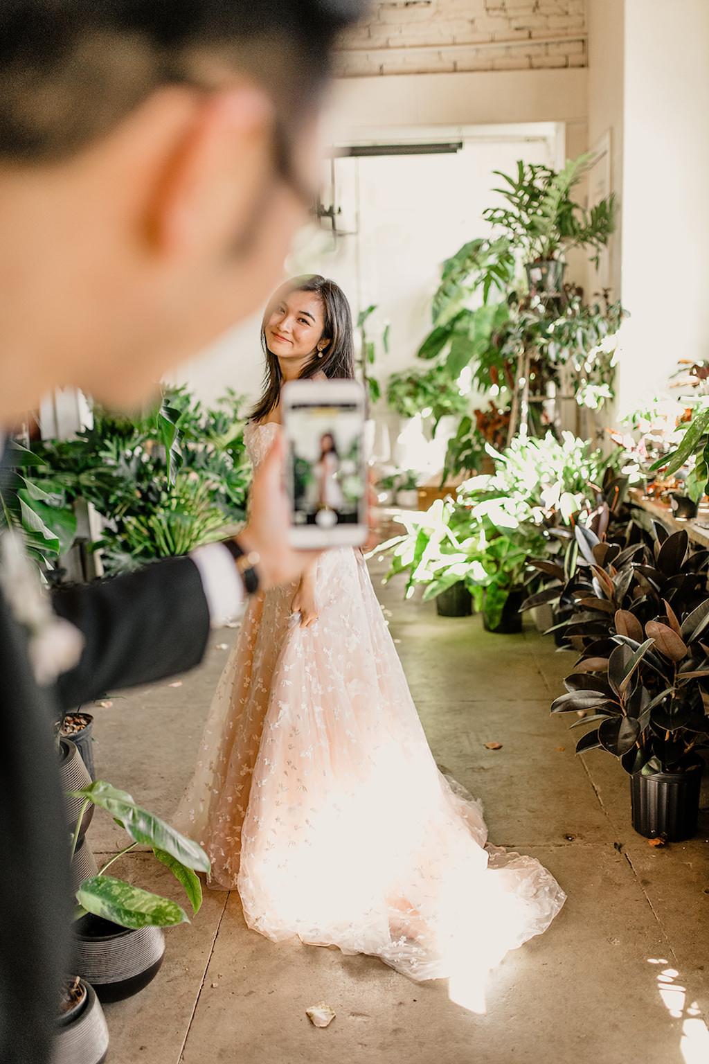 Bride and Groom Creative First Look Indoor Portrait, Bride in Peach Textured Wedding Dress