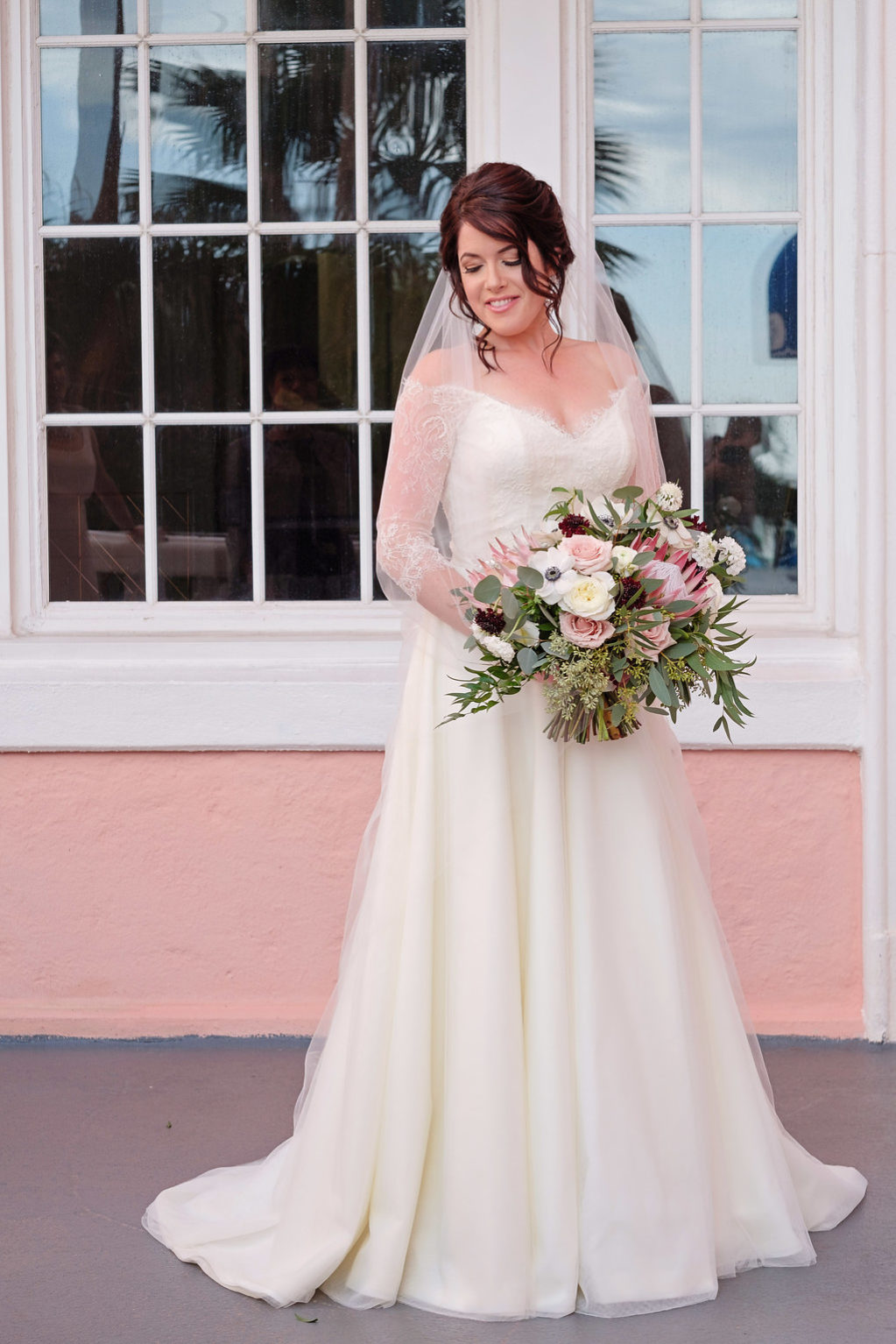 Outdoor Bridal Portrait in Lace Sleeve Wedding Dress with Blush Pink, White, and Burgundy Bouquet with Greenery   Tampa Bay Wedding Hair and Makeup Femme Akoi Beauty Studio   St Pete Photographer Marc Edwards Photographs