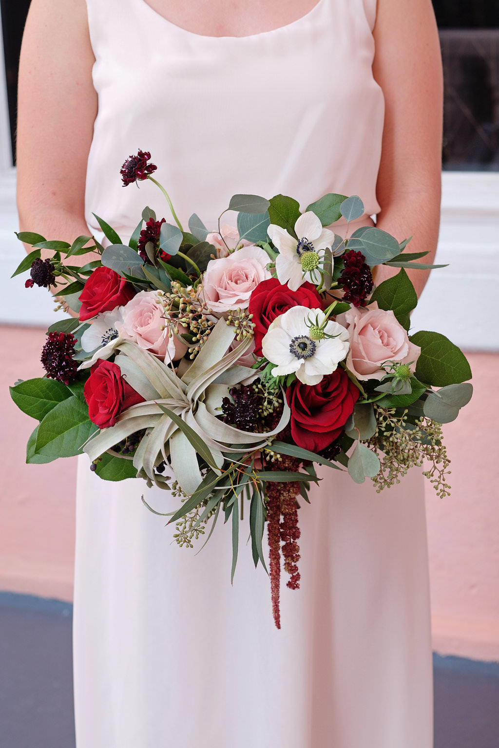 Outdoor Bridesmaid Portrait with Red and Pink Rose, Anemone, and Burgundy Floral with Greenery Bouquet | St Pete Wedding Photographer Marc Edwards Photography