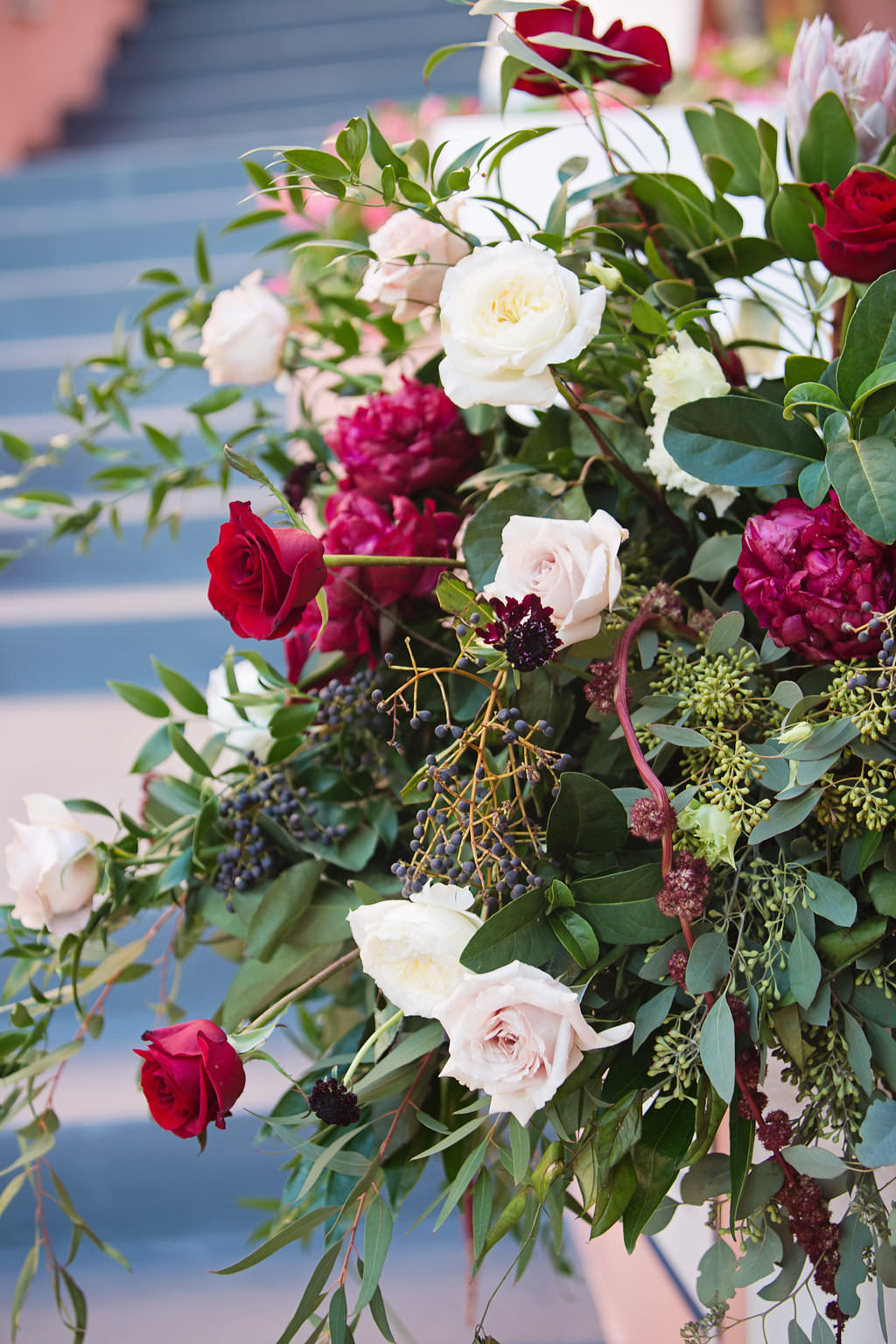 Outdoor Wedding Flower Arrangement with White and Red Roses with Greenery