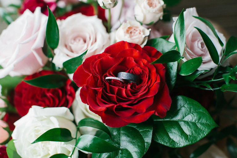 Carved Oxidized Silver Black Mens Wedding Ring and Diamond Wedding Band on Red and Pink Rose with Greenery Bouquet