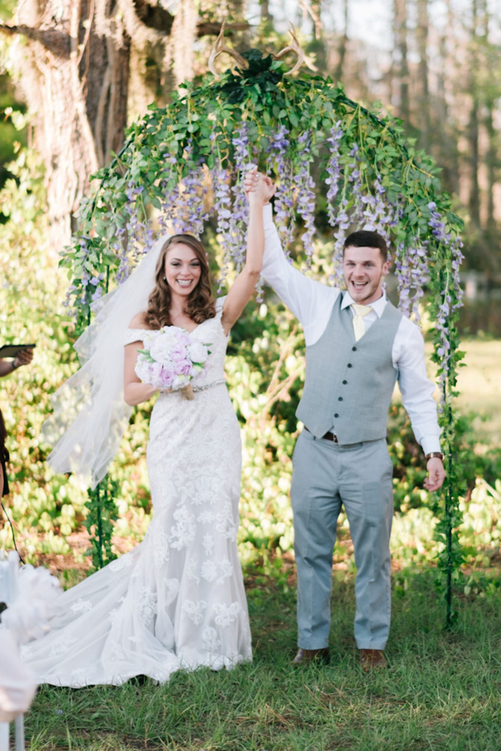 Outdoor Farm Wrought Iron Wedding Ceremony Arch with Hanging Purple Lilac Floral and Greenery | Tampa Bay Rustic Chic Private Home Estate Wedding Venue Southern Plantation Oasis
