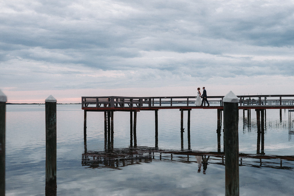 Creative Outdoor Waterfront Wedding Portrait on Dock | Tampa Bay Wedding Photographer Grind and Press Photography | Dunedin Venue Beso Del Sol
