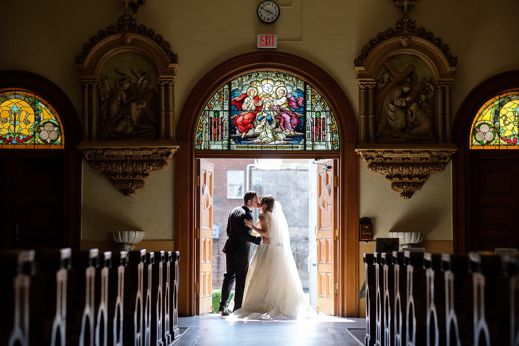 Wedding Ceremony Exit Portrait at Downtown Tampa Traditional Wedding Ceremony Venue Sacred Heart Catholic Church | Tampa Bay Photographer Marc Edwards Photographs