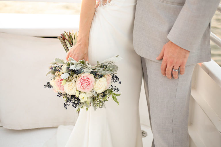 Outdoor Waterfront Wedding Portrait, Groom in Grey Linen Suit, Bride with Blush Pink and White Rose with Blue Berries and Greenery Bouquet | Clearwater Beach Unique Wedding Venue Yacht Starship | Photographer Lifelong Photography Studios