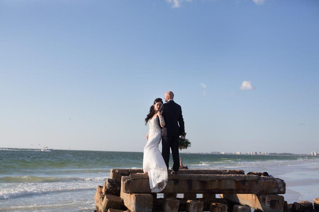 Outdoor Beach Wedding Bridal Portrait, Bride in V Neck Off The Shoulder Lace Long Sleeve Brides by Demetrios Dress, Groom in Navy Blue Vera Wang Suit | Sarasota Wedding Photographer Djamel Photography
