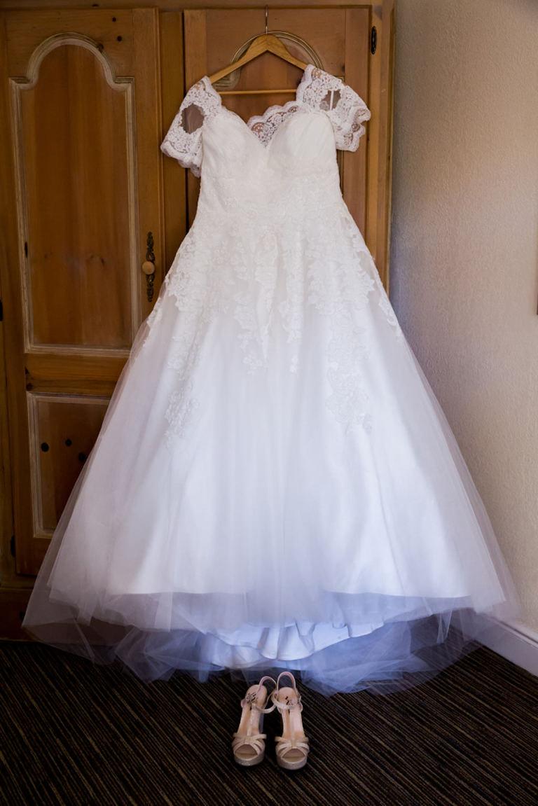 Lace Cap Sleeve Ballgown Pronovias Wedding Dress on Hanger with Rose Gold Peep Toe Platform Wedding Shoes