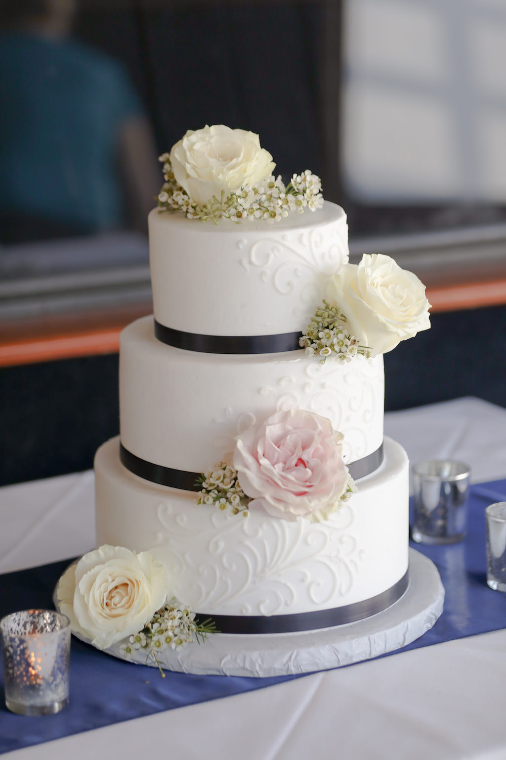 Three Tiered Round White Wedding Cake With Blush Pink And White