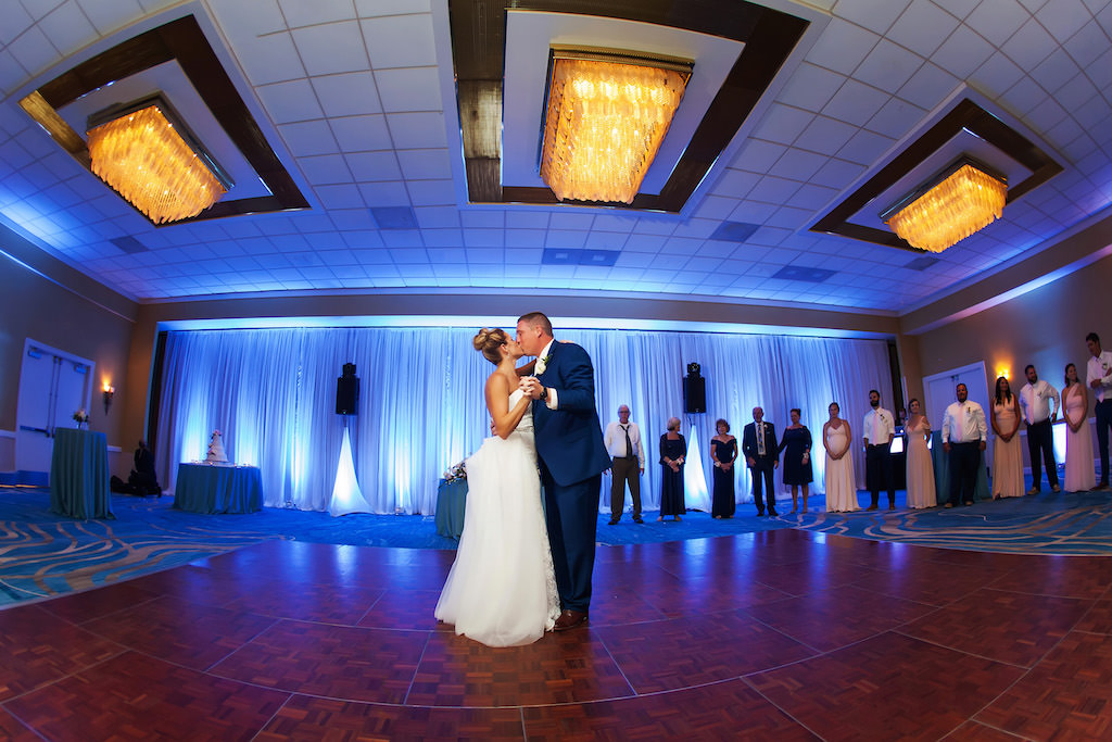 Indoor Hotel Ballroom Wedding Reception First Dance Portrait Groom In Blue Suit With Blue Linens Draping And Uplighting Waterfront Tampa Bay Hotel Wedding Venue Hilton Clearwater Beach Marry Me Tampa