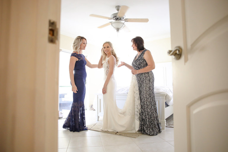 Bride Getting Ready Portrait with Mother and Bridesmaid in Cut Out Lace Side Column Dress, Bridesmaid in Blue Lace Dress | Tampa Bay Wedding Photographer Lifelong Photography Studio