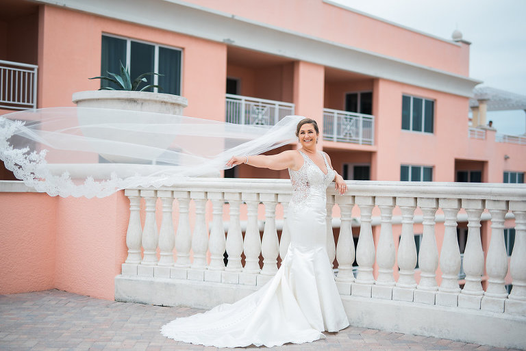 Outdoor Waterfront Hotel Rooftop Portraits, Bride in Lace Illusion Back V Neck Mermaid Dress | Tampa Bay Wedding Photographer Kera Photography | Venue Hyatt Regency Clearwater Beach