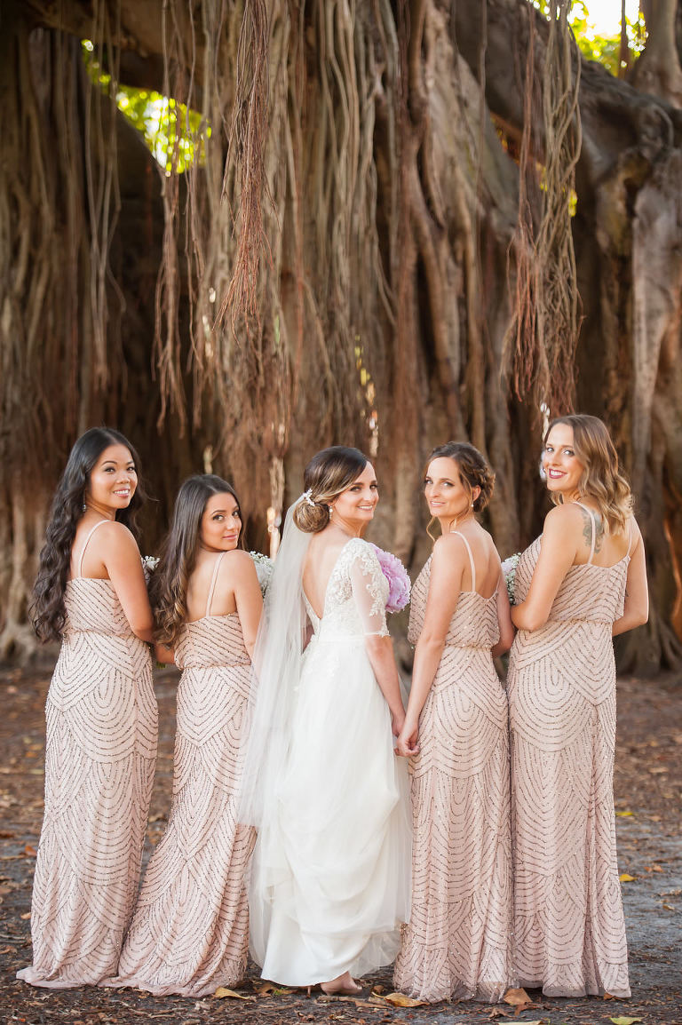Outdoor Bridal Party Portrait with Banyan Trees, Bride in V Back Lace Sleeve Davids Bridal Dress, Bridesmaids in Beaded Column Blush Pink Adrianna Papell Dresses | Downtown St Pete Wedding Cermony Venue North Straub Park