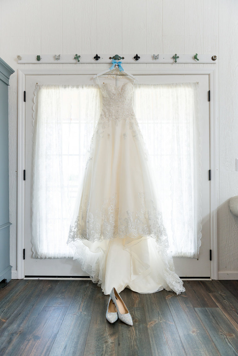 David's Bridal Ballgown Lace WEdding Dress On Hanger with Silver Pointed Wedding Shoes