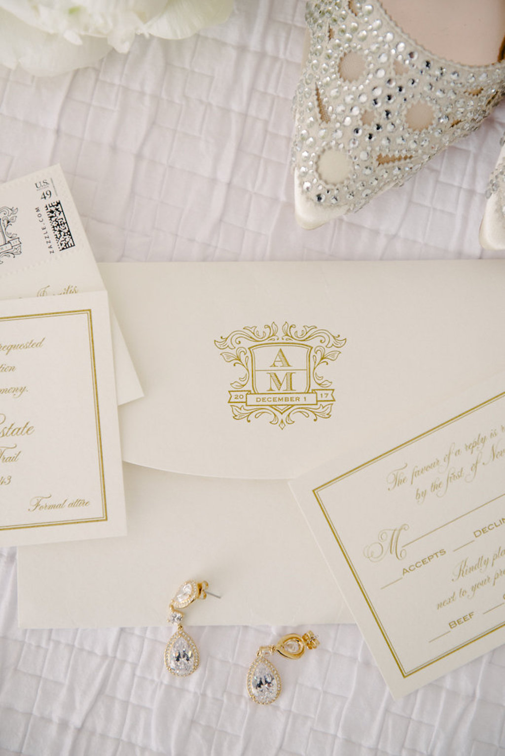 White and Gold Elegant Wedding invitation Suite with Custom Monogram, Drop Blue and Rhinestone Gold Earrings and Pointed Toe Wedding Shoes | Tampa Bay Wedding Stationery and Paper Goods URBANcoast