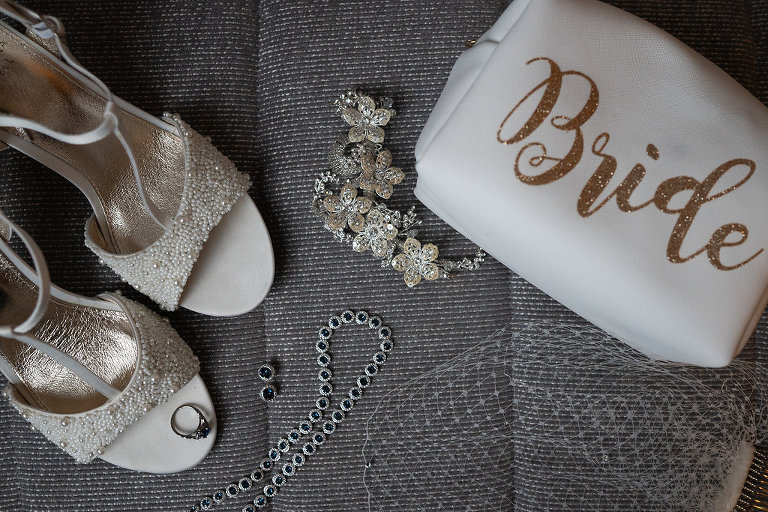 Beaded White Open Toe Strappy Sandal Wedding Shoes with Blue Gemstone Silver Wedding Jewelry, Floral Accessory, and Gold Glitter Bride Clutch