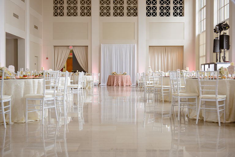 Elegant Wedding Reception with Round Tables, White Chiavari Chairs and Ivory Linens, Pink textured Linen Sweetheart Table with White Draping | Downtown Tampa Wedding Venue The Vault