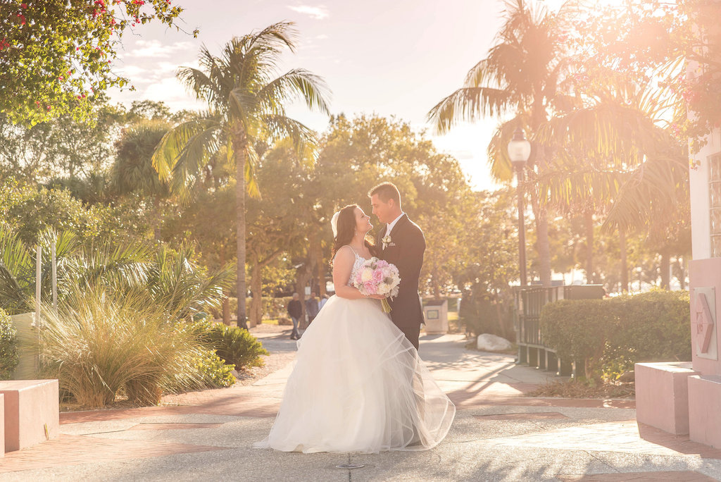 Outdoor Tropical Garden Wedding Portrait, Bride in Layered Ballgown Hayley Paige Dress with Veil and White and Pink Peony Bouquet with Greenery | Sarasota Wedding Photographer Kristen Marie Photography