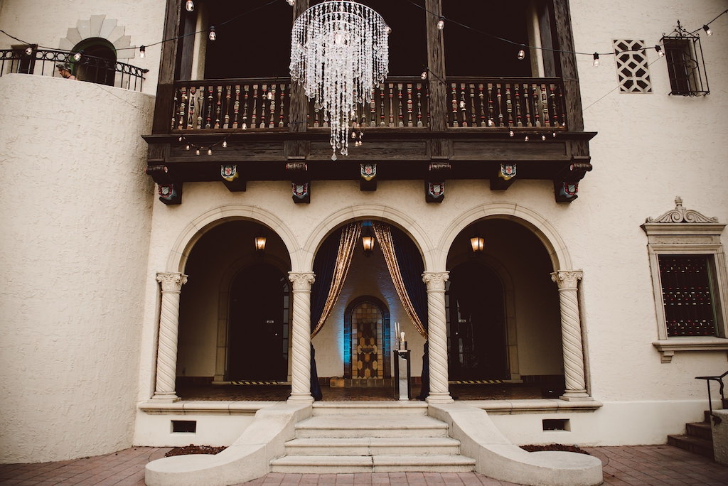 Vintage 1920s Glam Inspired Wedding Ceremony Decor with Crystal Chandelier, and String Lights   Sarasota Historic Wedding Venue Powel Crosley Estate