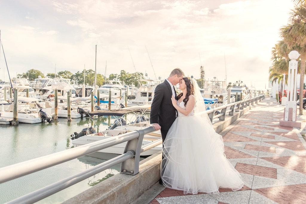 Outdoor Waterfront Marina Wedding Portrait, Bride in Layered Ballgown Hayley Paige Dress with Veil | Sarasota Wedding Photographer Kristen Marie Photography