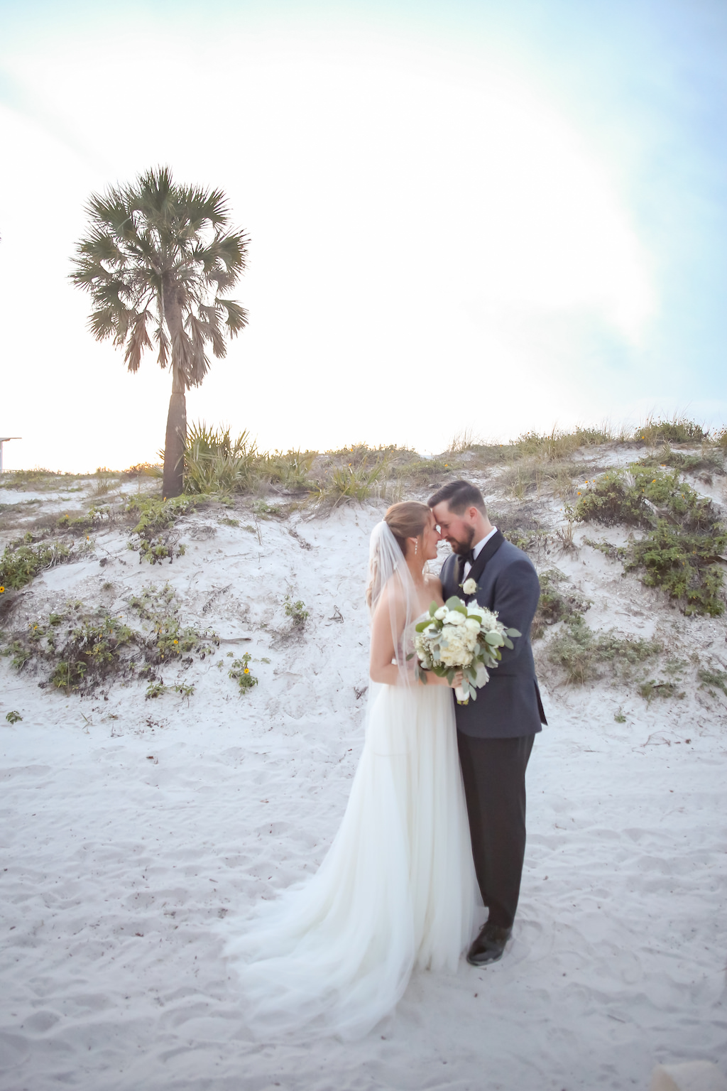 7907aab1b9 Outdoor Beach Wedding Portrait, Bride with White Floral and Greenery  Bouquet, Groom in Gray and Black Suit with Boutonniere | Tampa Bay Wedding  Photographer ...