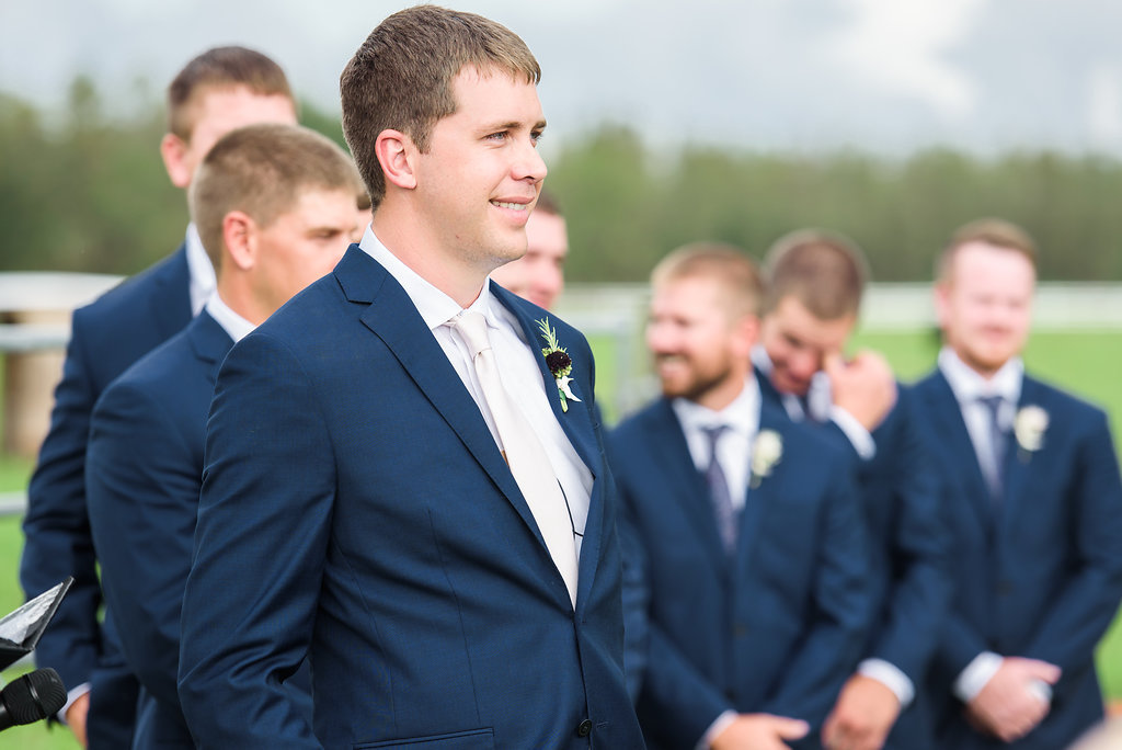 Outdoor Wedding Ceremony Portrait, Groom and Groomsmen in Navy Blue Men's Wearhouse and Joseph Abboud Suits with Ivory Ties, with Marsala Red and Greenery Boutonniere