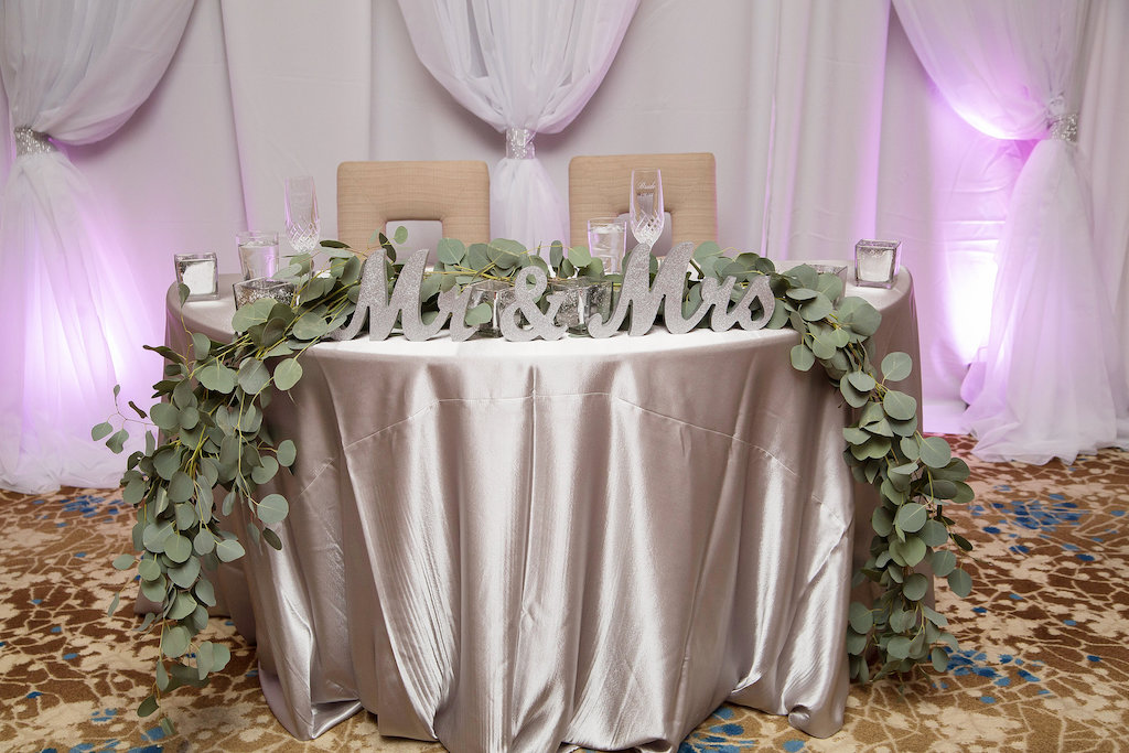 Modern Pink and Gray Wedding Reception Sweetheart Table with Satin Table LInen, White Draping, Oversized Mr and Mrs Silver Glitter Letters, and Greenery Garland Centerpiece | Downtown Sarasota Wedding Venue The Francis
