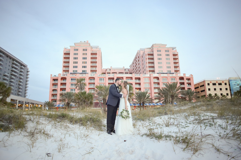 Outdoor Beach Wedding Portrait, Bride in Strapless Wtoo Bridal Dress with White Floral and Greenery Bouquet, Groom in Gray and Black Suit with Boutonniere | Tampa Bay Wedding Photographer Lifelong Studios Photography | Waterfront Hotel Venue Hyatt Regency Clearwater Beach