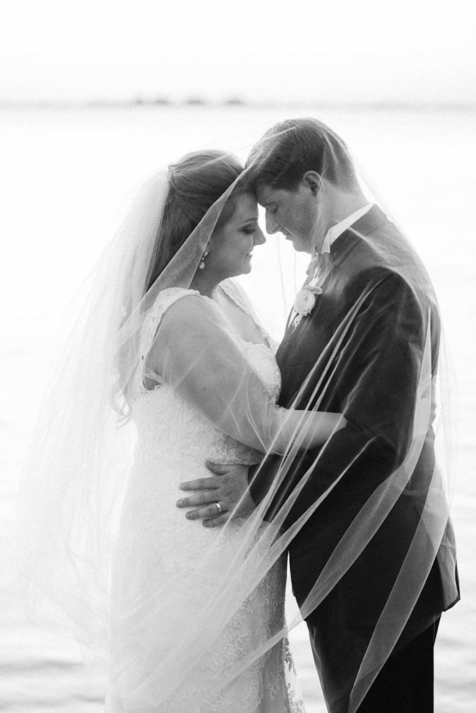Black and White Waterfront Florida Wedding Portrait Under Bridal Veil