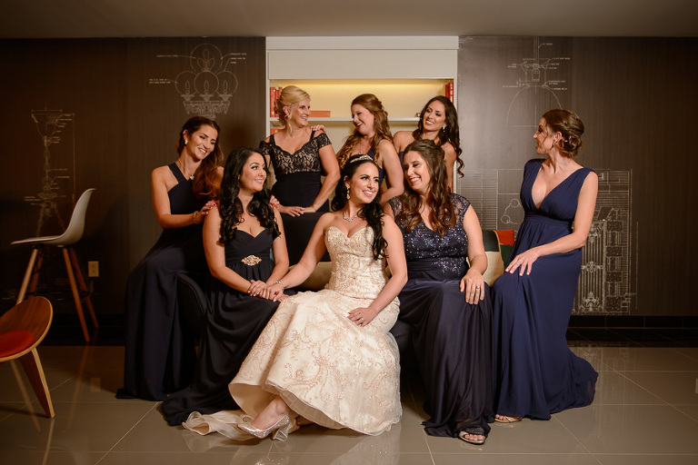 Bridal Party Getting Ready Portrait, Bride in Strapless Champagne Mermaid Wedding Dress, Bridesmaids in Mismatching Black and Dark Blue Dresses | Downtown Tampa Wedding Accommodations Le Meridien