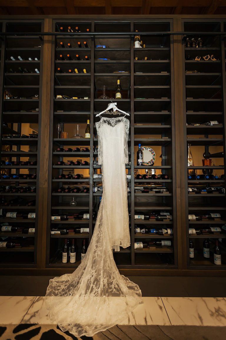 Illusion Lace Sleeve Wedding Dress and Veil on Custom Hanger in Wine Cellar