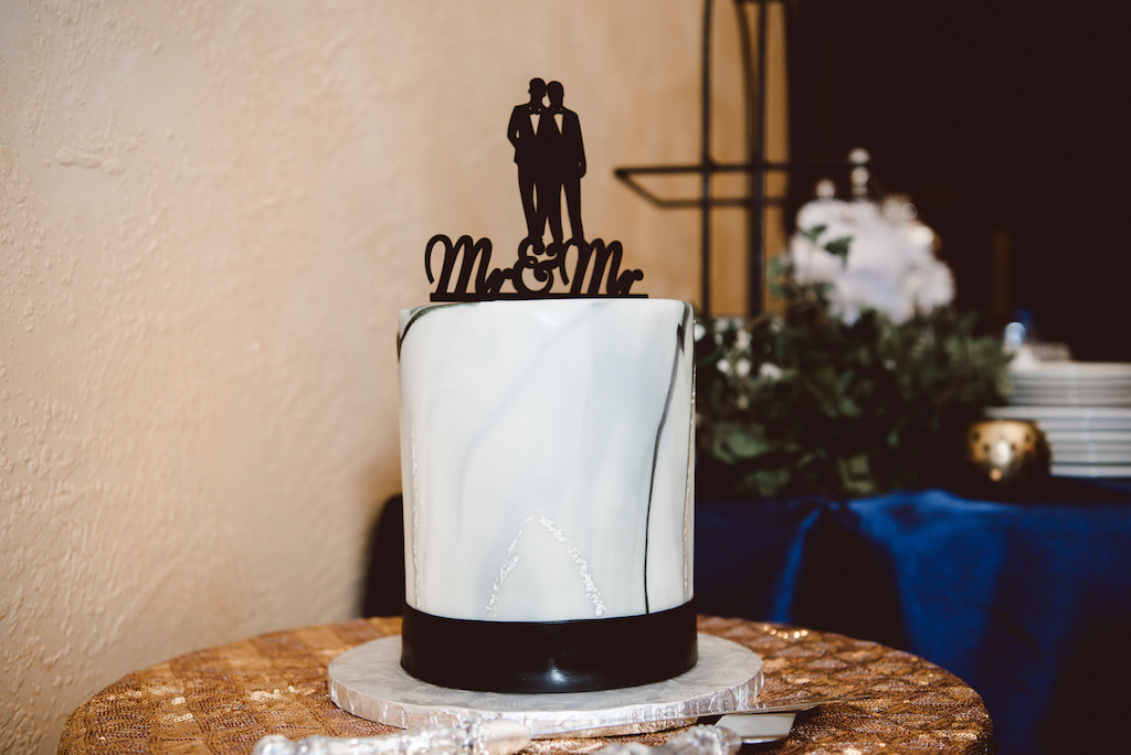 Single Tier Tall Round White and Blue Marble Wedding Cake on Marble Cakestand with Mr and Mr Same Sex Groom Silhouette Black Caketopper with Gold Sequin and Royal Blue Satin Linens