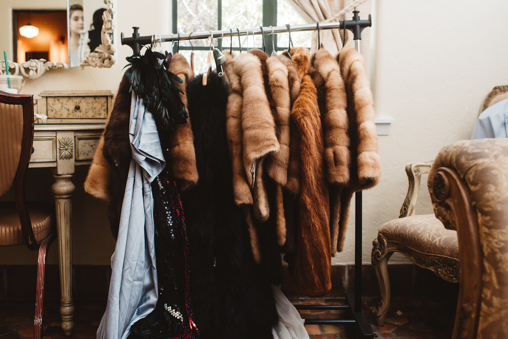 Glamorous 1920s Gatsby Inspired Same Sex Wedding Party Getting Ready Wardrobe Details with Fur Coats and Feather Boa