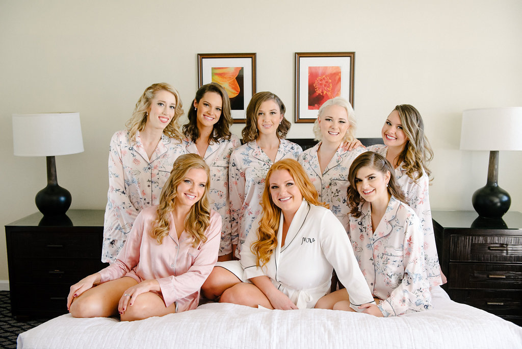 Indoor Bridal Party Getting Ready Portrait in Matching Blush Pink Patterned Pajamas