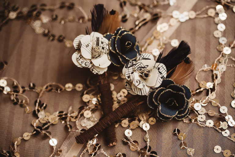 1920s Vintage Glam Inspired Wedding Paper Flower Boutonniere with Sheet Music and Black and Gold Glitter Petals and Feathers