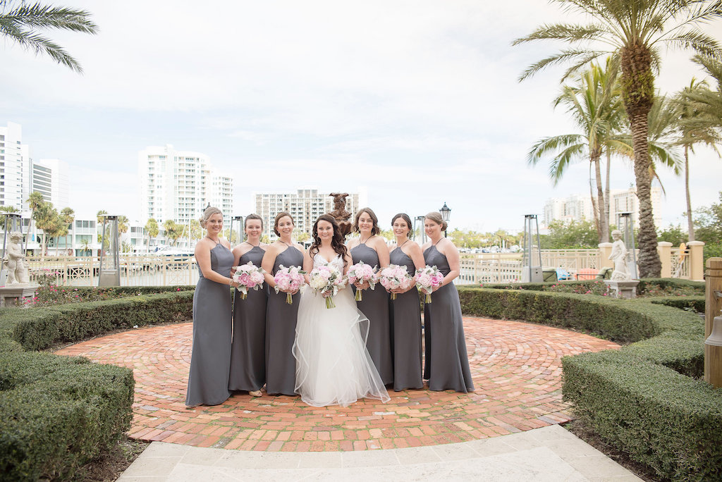 Outdoor Downtown Sarasota Park Bridal Party Portrait, Bride in Ballgown Hayley Paige Dress, Bridesmaids in Halter Gray Column Dresses with PInk Peony and Greenery Bouquets | Sarasota Wedding Photographer Kristen Marie Photography