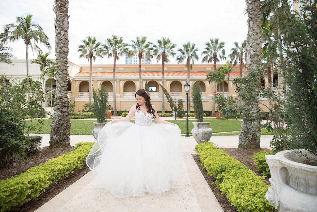 Outdoor Garden Courtyard Bridal Portrait wearing Lace Bodice Layered Ballgown Hayley Paige Dress | Sarasota Wedding Photographer Kristen Marie Photography