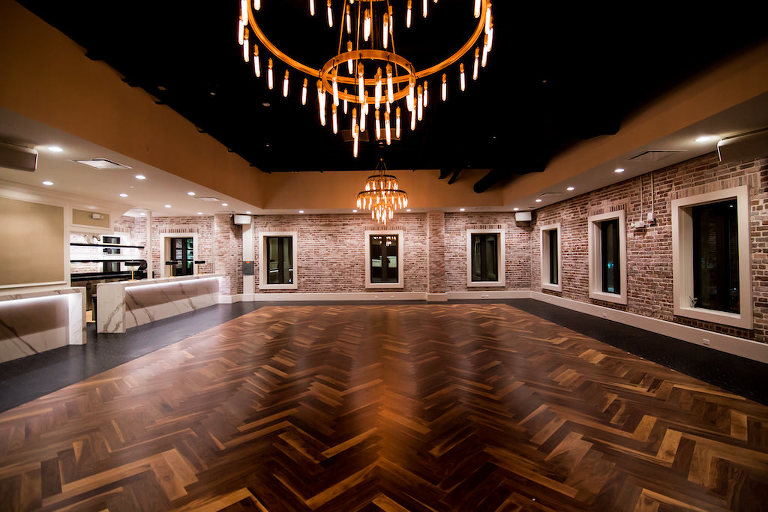 Downtown St Pete Modern Industrial Chic Wedding Venue Red Mesa Events with Marble Bar, Exposed Brick Walls, Vintage Chandelier, and Natural Wood Floors