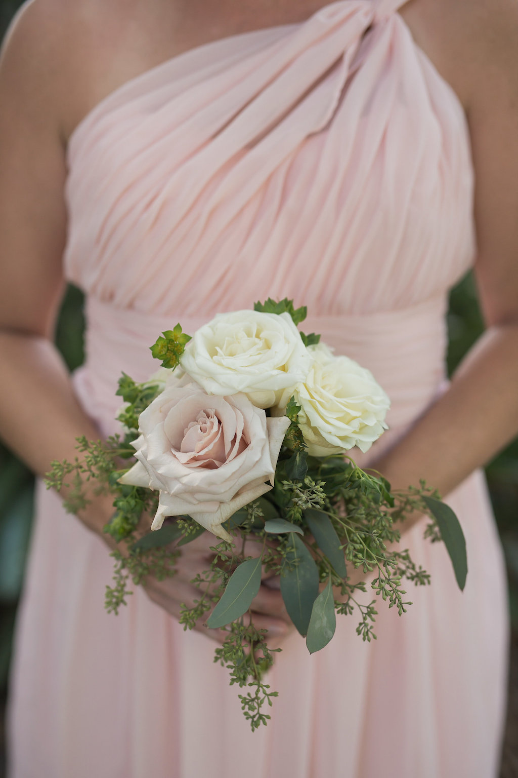 Bridesmaid in Blush Pink Bridesmaid Dress Holding Bouquet with Blush Pink Rose and White Roses and Greenery