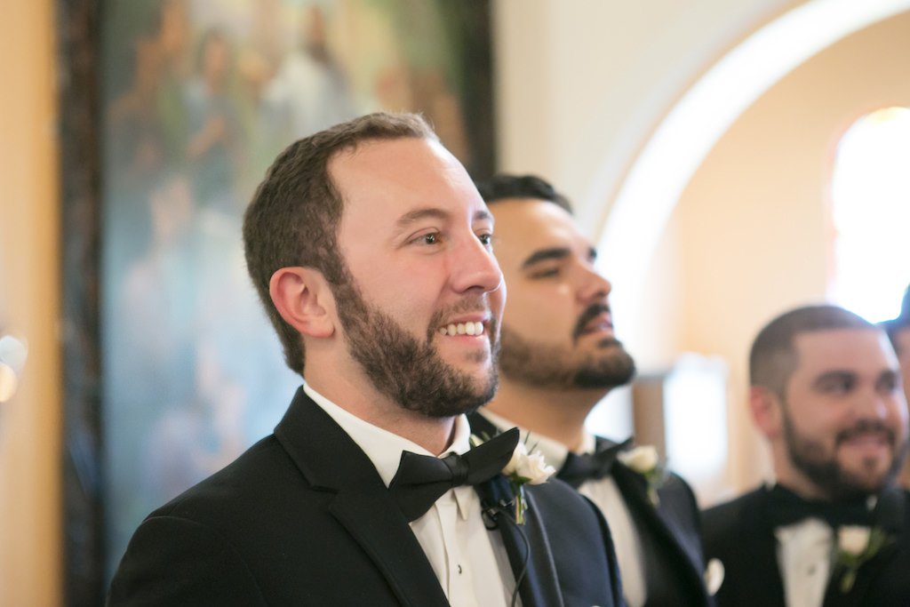Traditional Church Wedding Ceremony Portrait, Groom and Groomsmen in Black Tuxedos with Bow Ties and Blush Rose and Greenery Boutonniere   Tampa Wedding Photographer Carrie Wildes Photography