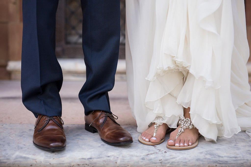 Bride and Groom's Wedding Portrait Wearing Beaded Beach Sandals and Brown Dress Shoes