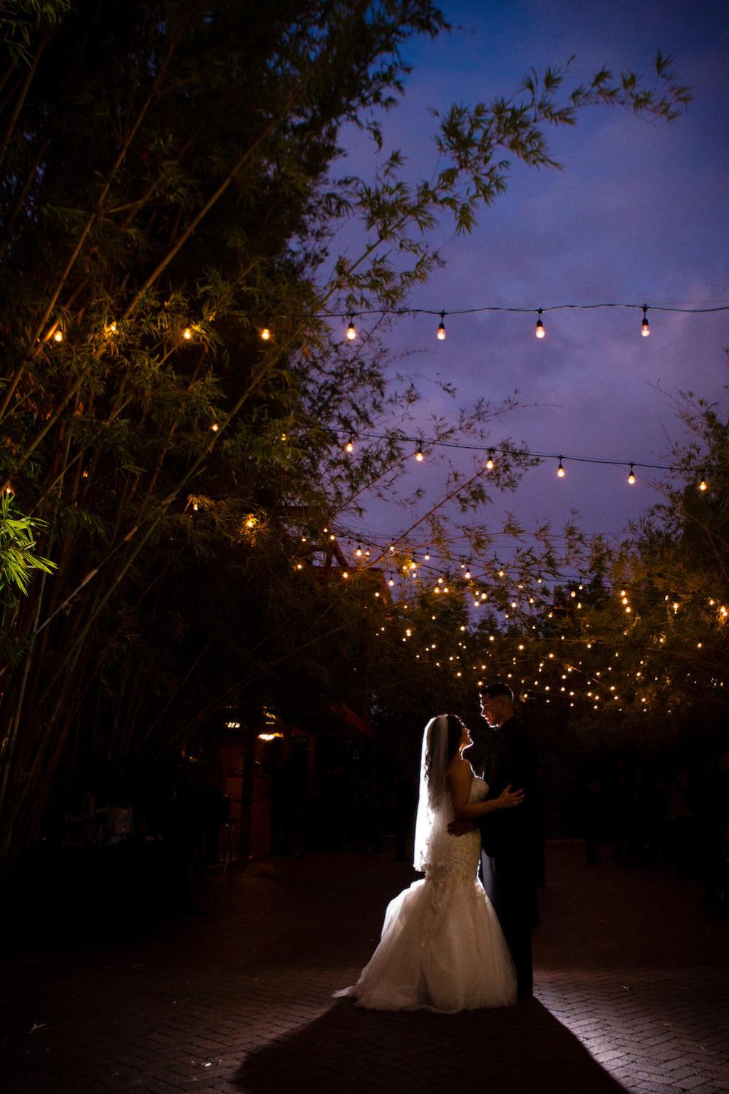 Nighttime, Twilight Bride and Groom Outdoor Wedding Portrait with Hanging Bistro Lights   Downtown St. Pete Wedding Venue NOVA 535