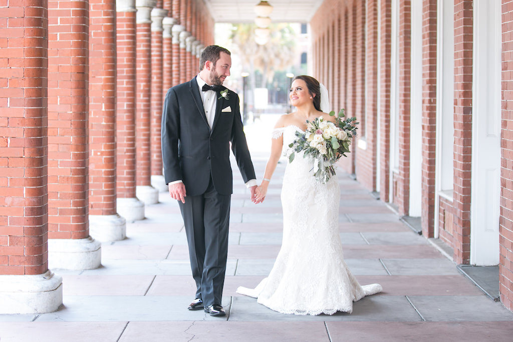 Outdoor Wedding Portrait, Bride in Off The Shoulder Lace Augusta Jones Dress with Cream, Blush, Mauve Rose and Thistle Bouquet with Greenery, Groom in Black Tux with Bow Tie and Pink Pocket Square | Tampa Bay Wedding Photographer Carrie Wildes Photography