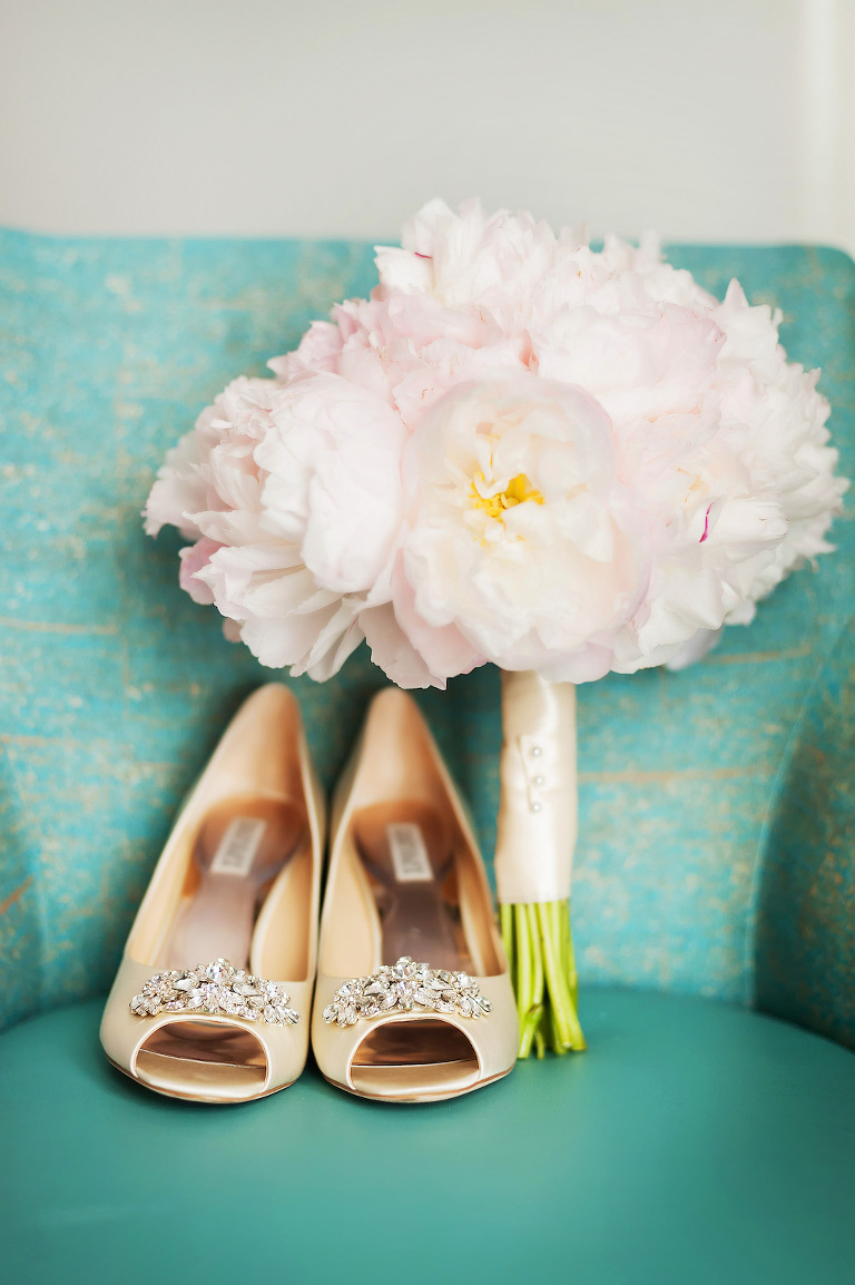 Bride's Gold Wedding Heels on Turquoise Couch with Blush Pink Peonies Bouquet Wrapped in Silk Ribbon