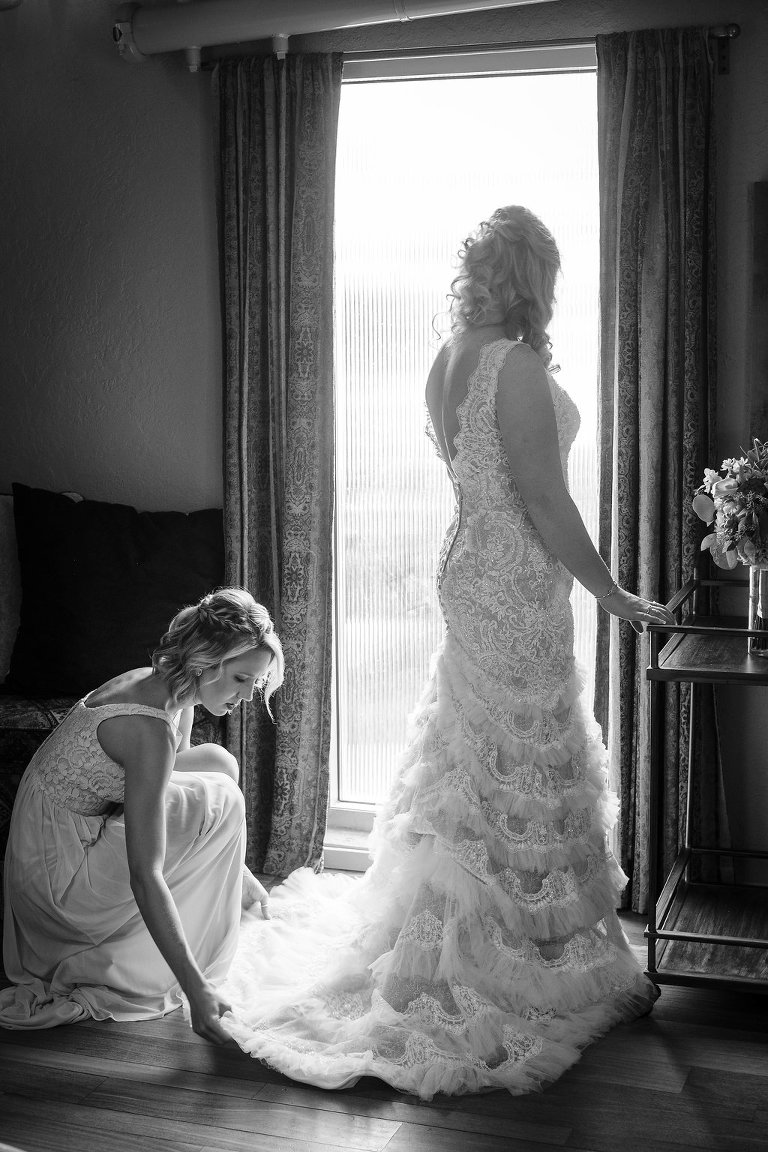 Black and White Bride Getting Ready Portrait in Fit and Flare Lace and Ruffle Skirt Wedding Dress with Tank Top Straps and Plunging V-Neckline | St. Pete Photographer Marc Edwards Photography