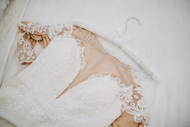 Lace Sleeve David's Bridal White and Nude Lace Wedding Dress on Personalized Hanger | Tampa Bay Wedding Photographer Rad Red Creative
