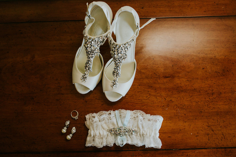 Off-White Lace Garter with Crystal Detail and Blue Ribbon and Jeweled Open Toe Wedding Shoes and Diamond Teardrop Earrings and Wedding Ring