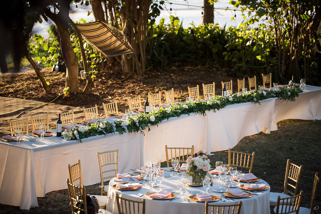 Wedding Reception Rectangular Feasting Sweetheart Table Decor with Grey Linen Wine Bottles, Greenery and White Flowers and Circular Reception Table with Grey Linen Grey Chiavari Chairs Mason Jar Centerpiece Gold Chargers Pink Blush Napkins