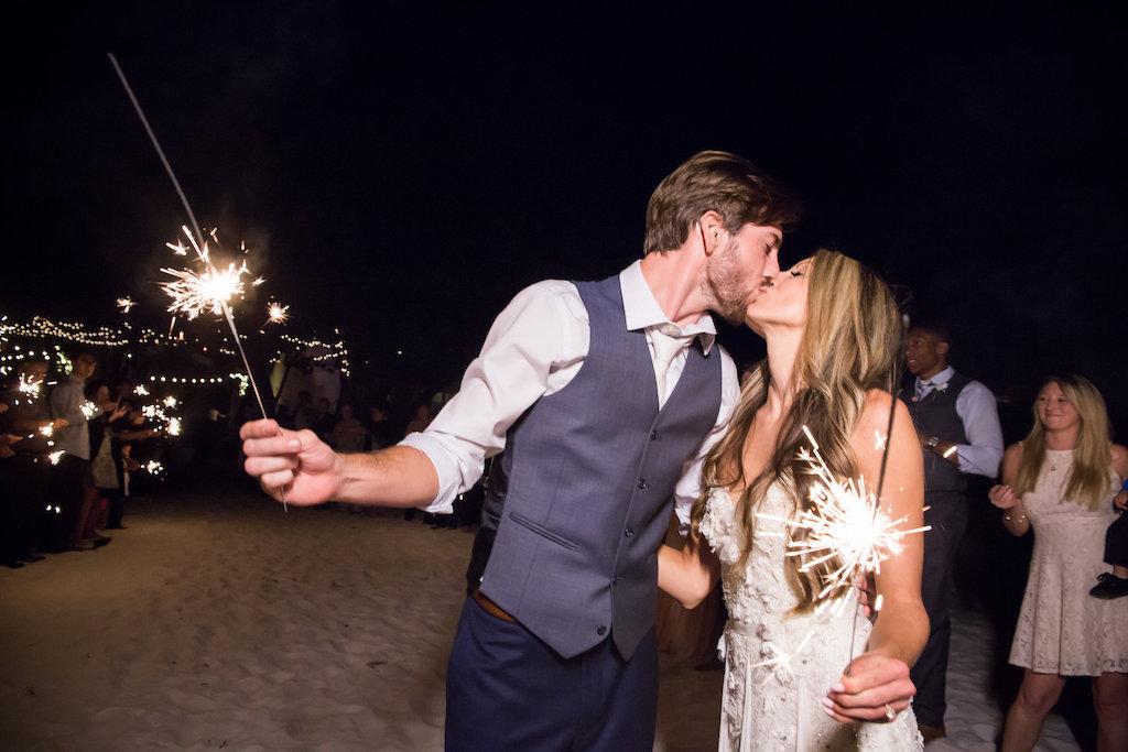 Bride and Groom Nighttime Siesta Key Beach Wedding Portrait Kissing Holding Sparklers   Sarasota Wedding Photographer Cat Pennenga Photography