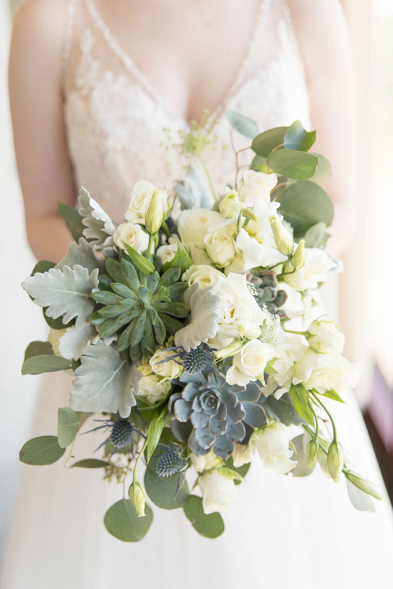 Indoor Bridal Portrait Watters Bride Plunge Line Lace Tank Strap Wedding Dress with White Roses Dusty Miller Succulents Bridal Bouquet | Tampa Bay Wedding Photographer Kristen Marie Photography